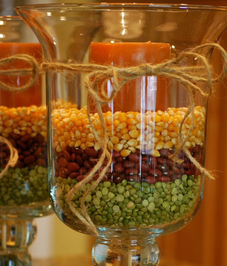 Fall Hurricane Vases:  corn kernels, small red beans, split peas, black beans, White Northern Beans and Red Lentils. Place the candle in empty hurricane, then begin pouring beans very slowly around candle to desired level. Repeat layers with different beans. Tie fun ribbon or let stand alone!