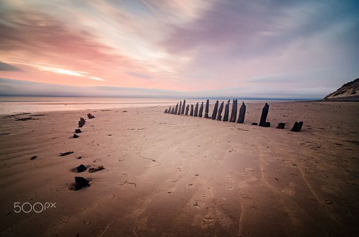 """Bones - wreck of the Sunbeam - Bones - the remains of the Sunbeam, a schooner that ran ashore on it's maiden voyage in 1903 onto Rossbeigh Strand, Co. Kerry. It lay still on the strand for over 100 years but a storm in 2015 moved it downshore and gradually the beach and weather has broken it down to the few visible bones we see here.  Stay in touch: <a href=""""https://www.facebook.com/kathrynconwayphotography"""">Facebook Page</a>, <a href=""""https://instagram.com/conwaykathryn/"""">Instagram</a> or…"""