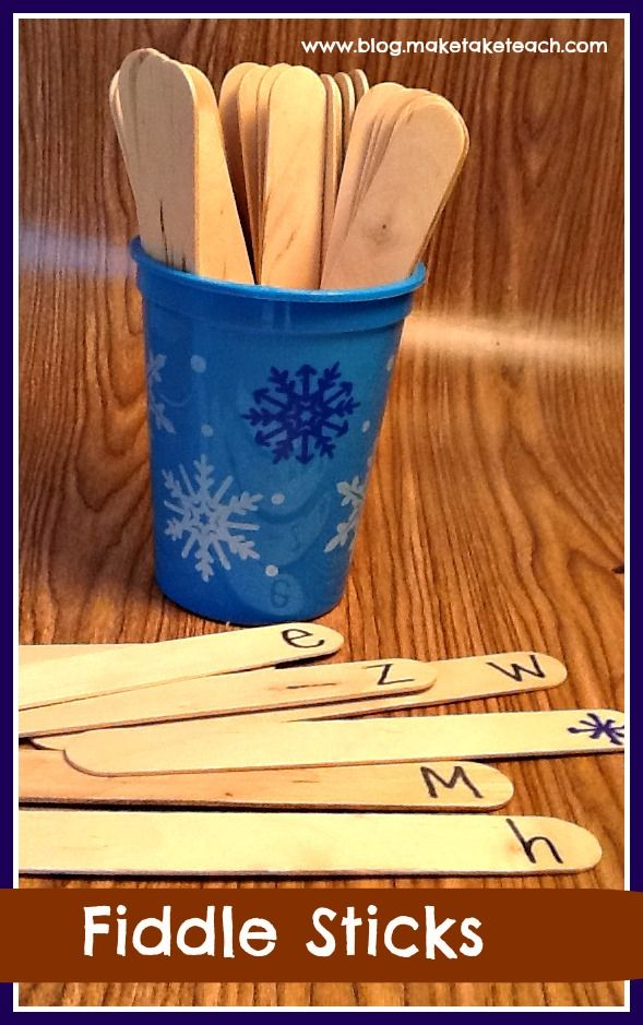 """Fiddlesticks game - write letters on one end of craft sticks.  Add some with a symbol like a dot, sad face, or lightening rod (example uses snowflake to match cup).  Put sticks in cup face down.  Player chooses stick.  If they can name it, the keep it.  If they get a symbol stick, all their sticks go back in the cup.  After a certain time limit, player with most sticks """"wins"""""""