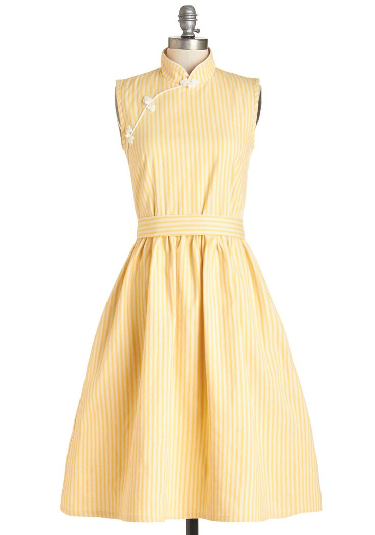 Knotted faux-buttons, a stand-up collar, subtle yellow stripes... the delight is in the details!