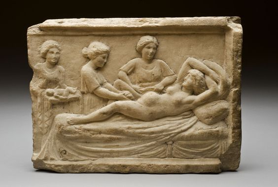 Roman marble relief from Ostia with a parturition scene. The funerary relief