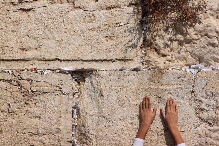 Woman praying at Western Wall Jerusalem, Israel.