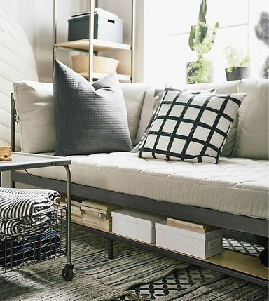 Space saving furniture is a perfect solution as small apartment furniture. IKEA has a smart sofa called EKEBOL in beige and steel that has smart shelves  for storage underneath and behind it.