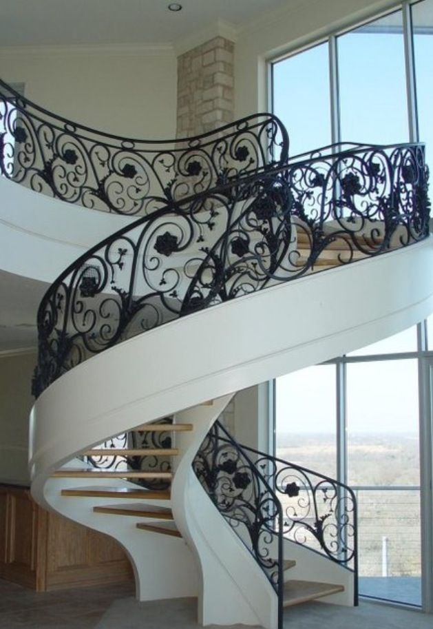 Spiral staircase in a luxury home interiors for Spiral staircase house