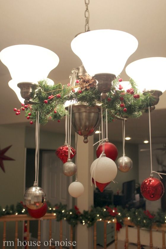 hang Christmas ornaments from chandelier