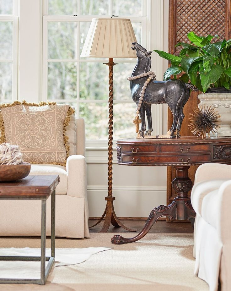 An antique table adds the patina of old wood to the family room. Interior design by Lyndsy Woods. Image by Marc Mauldin. See more at www.StyleBlueprint.com.