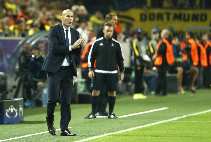 Real Madrid's French coach Zinedine Zidane reacts during the UEFA Champions League first leg football match between Borussia Dortmund and Real Madrid at BVB stadium in Dortmund, on September 27, 2016.