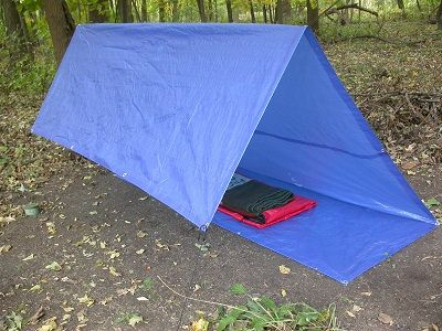 "A ""Tarp Shelter""...  Yes, there are better ways to create a shelter from a tarp, other than just laying it on the ground or something.  Check out these ideas!  And ways to make it better! #Camping #Outdoor #Shelter"