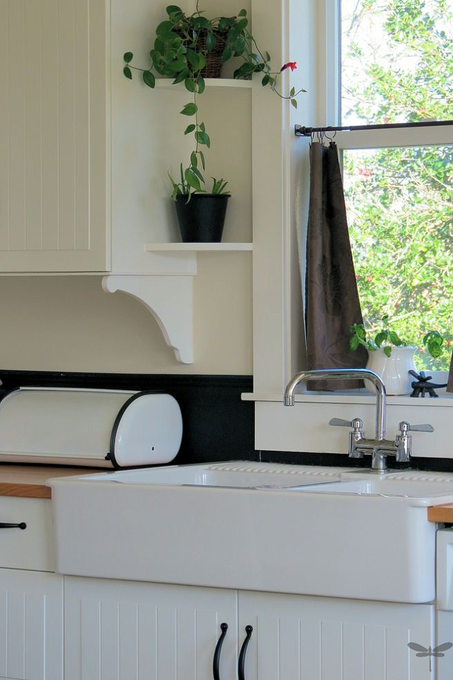 How to turn ordinary cabinets into cottage classics for Window under kitchen cabinets