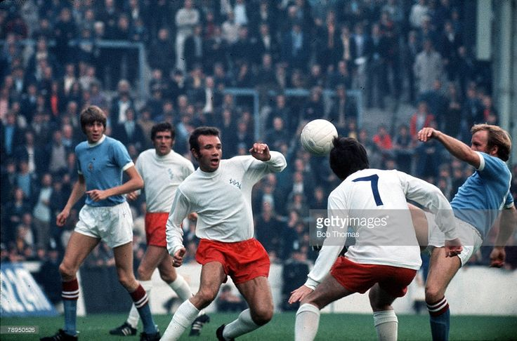 14th August 1971, Maine Road, Manchester, Manchester City v Leeds United, Leeds defender Paul Reaney attempts to clear from Francis Lee.
