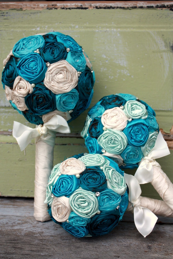 Bride's Bouquet, fabric flower bridal bouquet in teal, aqua and ivory silk rosettes, Shabby chic wedding bouquet for country wedding. $125.00, via Etsy.