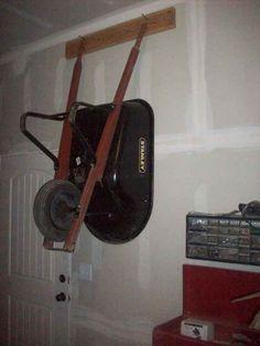 Wheelbarrow hanging on Garage Wall
