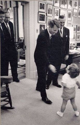 1963, 14 October John Fitzgerald Kennedy Jr., with Attorney General Robert Kennedy President Kennedy & two unidentified men