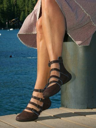 """Made in Germany. Trippen takes the gladiator sandal to the next level with the über-cool Army! Four straps encircle and are riveted to an open ankle boot—including one strap that actually goes under the sole. But what will make everyone stand at attention are the eye-catching blue edges of the Army's luscious mocha brown leather!  A cork insole conforms to your individual foot, while Trippen's rubber """"cups"""" outsole keeps your step lively because it's so lightweight."""