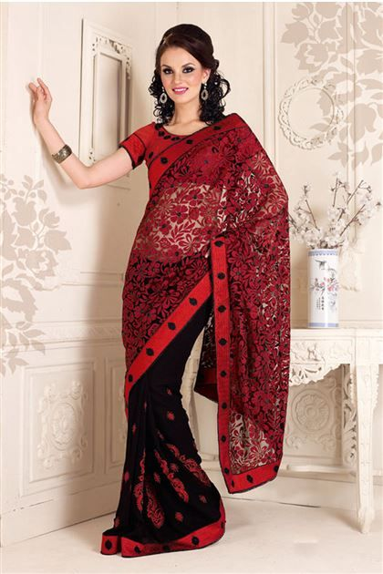"""This good looking Maroon Black Net Brasso Georgette designer saree with Maroon artsilk blouse and Zari, resham embroidery with stone work and patch patta Work, this saree is COSTUMIZED UP TO 40"""".  Find more details here http://www.jomso.com/Shop/Maroon-Black-Net-Brasso-Georgette-designer-saree/Jom_Hema_5014"""