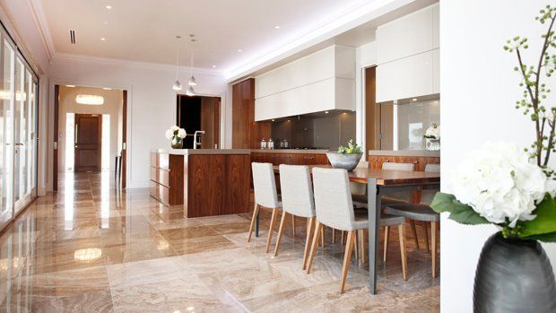 Polished tiles and warm, rich timber give a sense of luxury to the kitchen/dining areas...