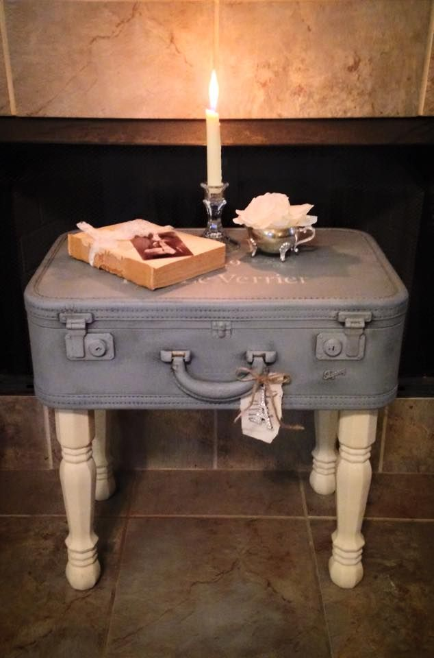 Suitcase table painted in a mix of Annie Sloan's Paris Grey and Graphite. Stencil and legs painted in Annie Sloan's Old Ocher. Inside was gutted and relined with a drop cloth. French Stencil was added to inside lid and grey lace was added as a trim.