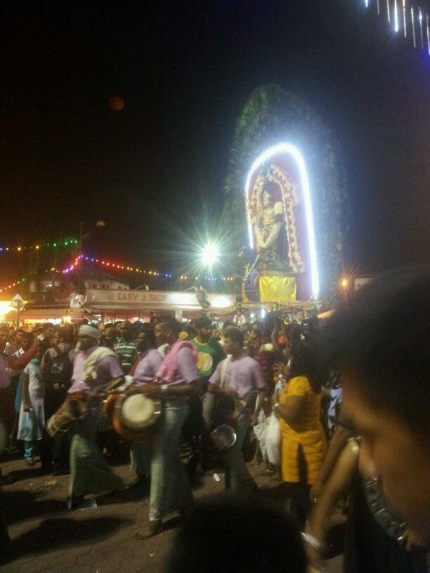 Thaipusam festival in Batu Caves. A devotee is carrying the kavadi. Its huge one.