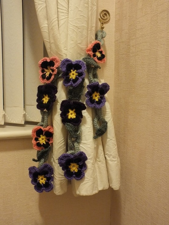 Crocheted pansy curtain tie back