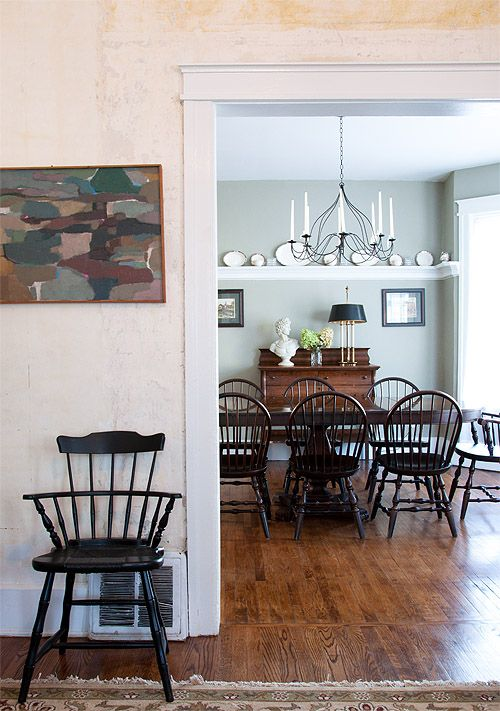 The Formal Dining Room Is Furnished With A Vintage Pedestal Oblong Table Dark Windsor Chairs Side Hutch And Cast Iron Candle Chandelier