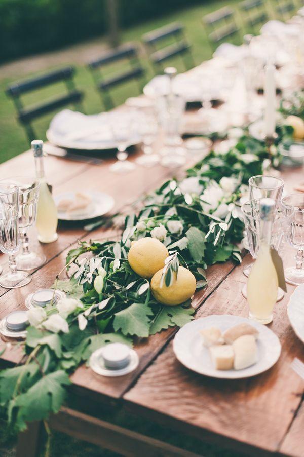 lemon and greenery table runner, photo by Lisa Poggi http://ruffledblog.com/tuscany-destination-wedding #weddingreception #tablerunner
