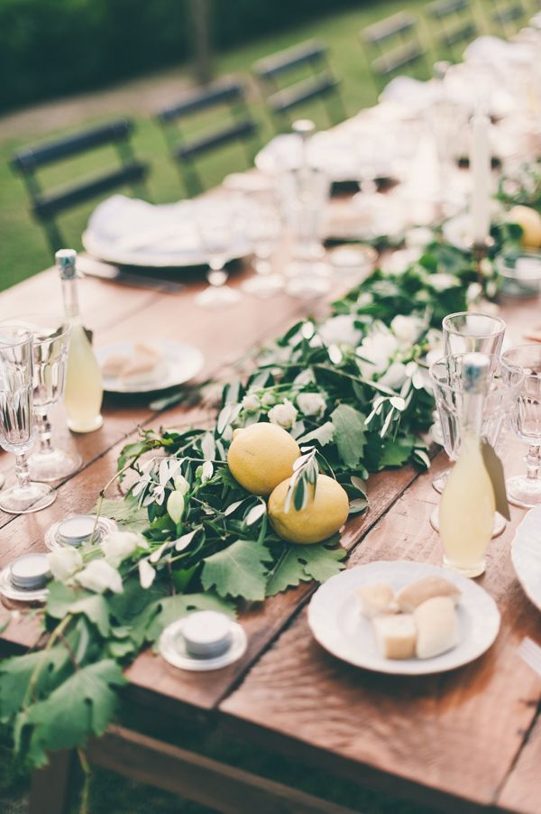lemon and greenery table runner, photo by Lisa Poggi | Greenery and Floral Garland Wedding Decoration | fabmood.com #garland #weddingreception #tablerunner