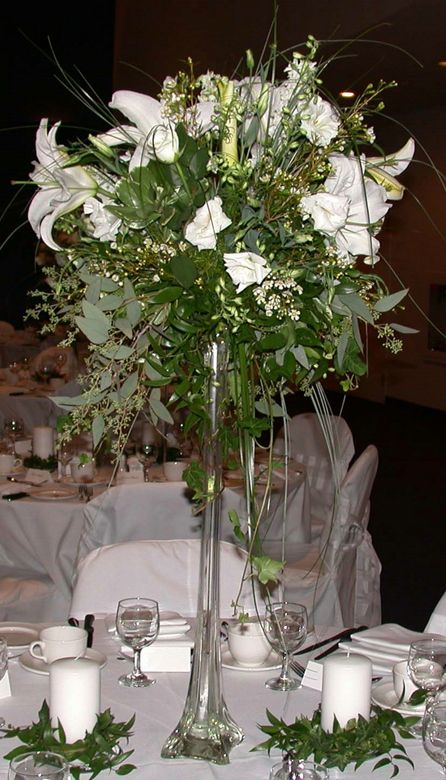 White Casablanca Lilies With Lisianthus And Wax Flower In An Eiffel Tower Vase Reception