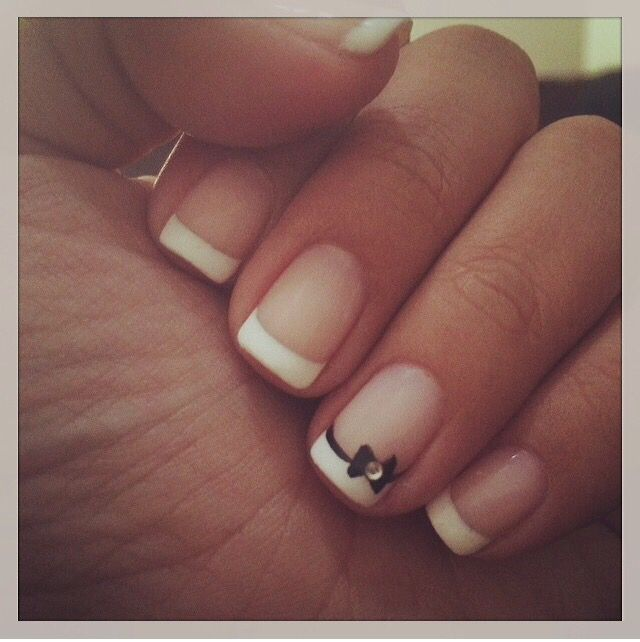 French tip with bow featured nail