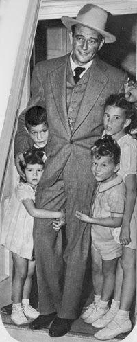 John Wayne in 1944, with his children. Michael, Patrick, Toni, and Melinda.
