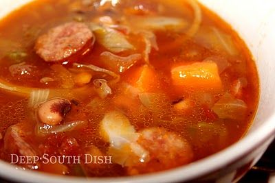 Sausage and Sweet Potato Soup with Black-eyed Peas and Cabbage - A beef broth and tomato based soup made with smoked sausage, sweet potatoes, black-eyed peas and cabbage.