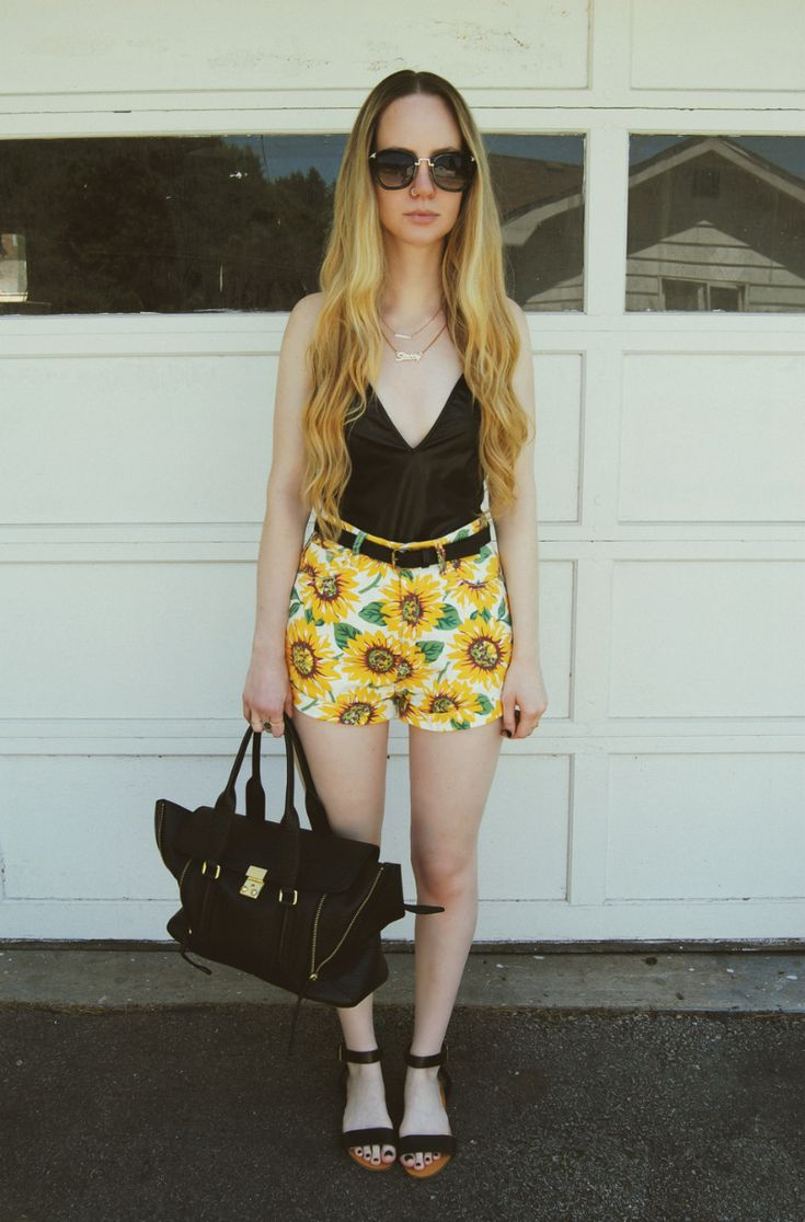 Shop this look for $76:  http://lookastic.com/women/looks/tank-and-belt-and-shorts-and-satchel-bag-and-flat-sandals/3222  — Black Silk Tank  — Black Leather Belt  — Yellow Floral Shorts  — Black Leather Satchel Bag  — Black Leather Flat Sandals
