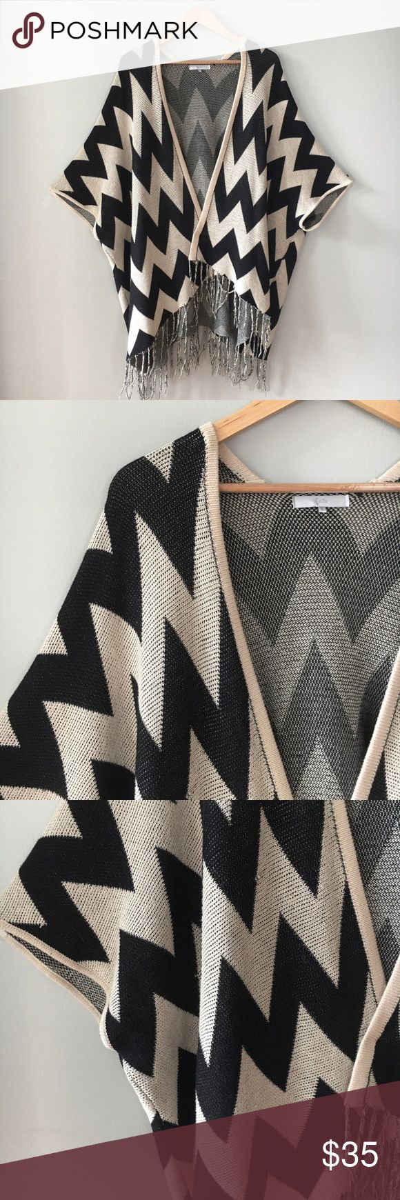 "Chevron Chunky Knit Kimono Fate Chevron chunky knit kimono Oversized cardigan in black and tan chevron  Open drape front  Fringe hem CARE: Hand wash cold or dry clean. Lay flat to dry. Cool iron if needed.  MATERIALS: 100% cotton  SIZE: Small  MEASUREMENTS: Approximately  32"" LENGTH (high point shoulder to hem) 25"" SLEEVE (nape of neck to cuff) 10.5"" SLEEVE OPENING 38"" BUST (armpit to armpit on backside)  Excellent condition. Runs big. Fate Sweaters Cardigans"