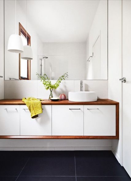 LOVE the sink console and those huge grey tiles.