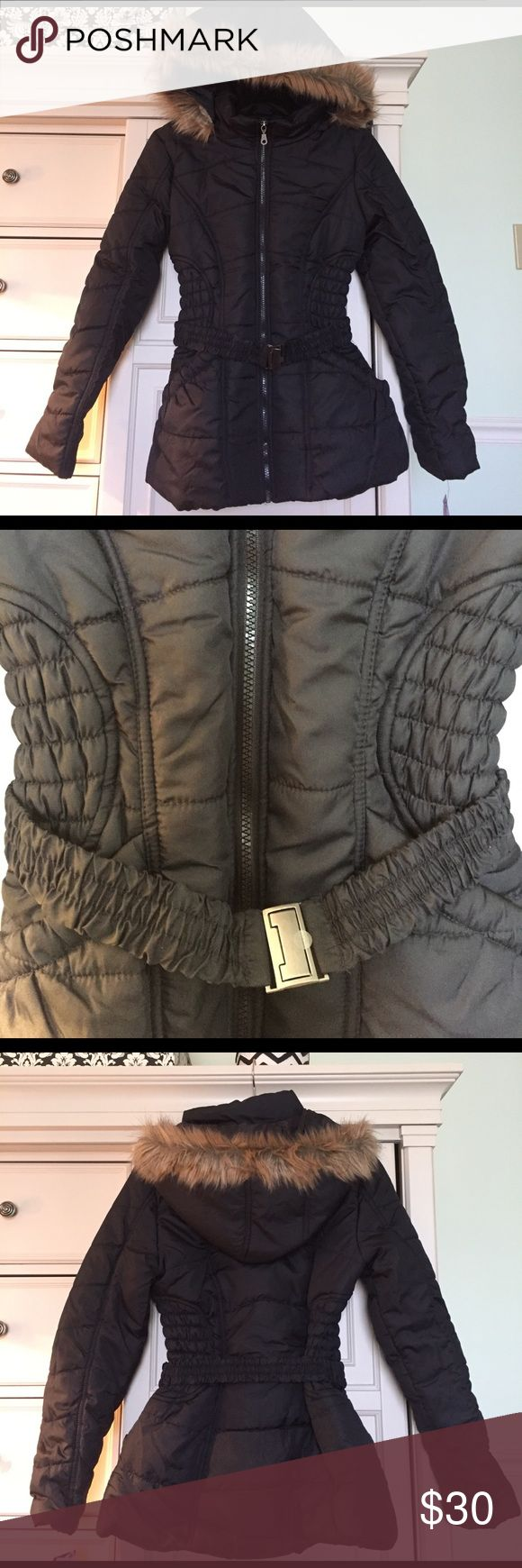 """Rampage Puffer Coat Stay warm in this super stylish coat. Mid-weight coat with slit pockets and faux fur lined removable hood. A belt creates a slimming effect and showcases the nicely down quilting. Hits at the hips- approximately 25"""" long Rampage Jackets & Coats Puffers"""