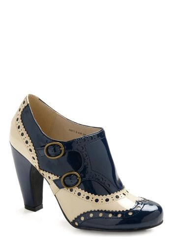 Blue Corn Cooking Shoes navy blue- and cream-colored heels' ingredients are faux