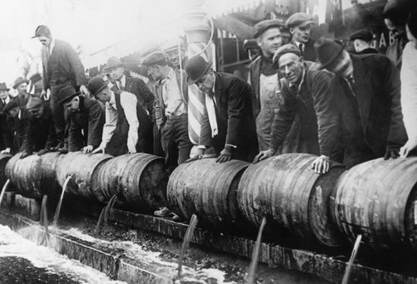 Police emptying kegs: Authorities empty barrels of beer into the sewers during prohibition.