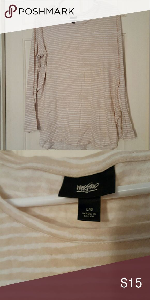 Long sleeve shirt Striped long sleeve shirt. A little oversized but looks great with leggings! Super comfy. Got from another posher but recently lost weight so this is too big for me now. Great condition. Tops