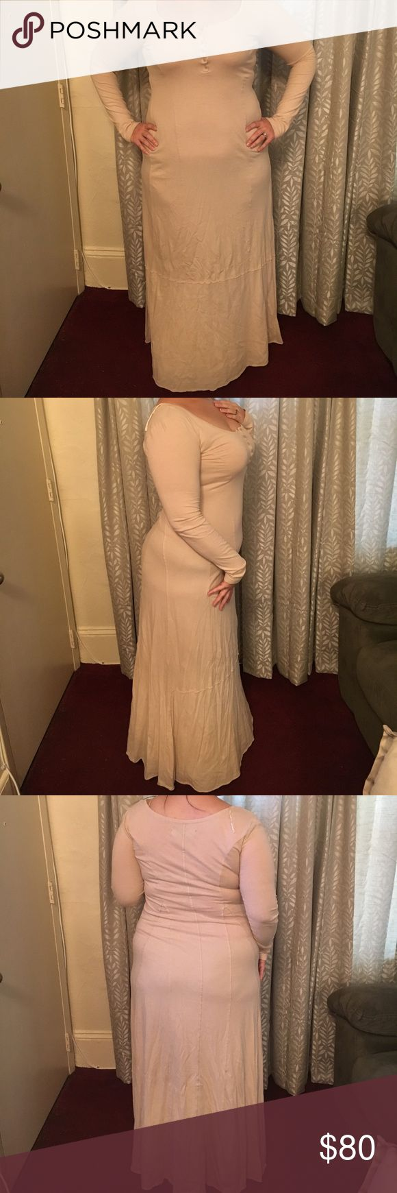 Free People Miles of Henley Dres Free People long sleeve beige maxi dress with Henley neckline. There are a few very slight discoloration sat the bottom of the hem that are almost unnoticeable, see last two pictures. Very comfortable and easy dress. 100% Cotton. Free People Dresses Maxi