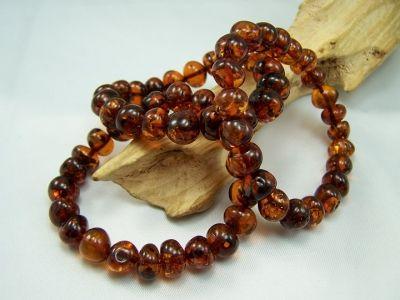 Cognac colour amber bracelet - round beads.
