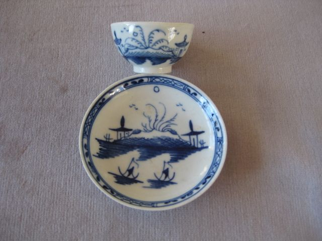 "A Caughley miniature tea bowl and saucer painted in blue with the  "" Island"" pattern  S mark to tea bowl Circa 1780Width of saucer  2 3/4"""
