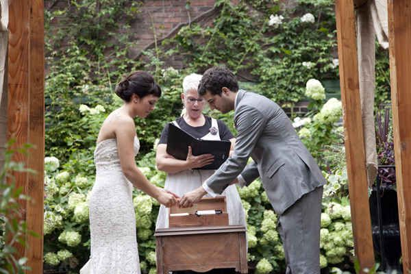 As part of your ceremony, seal love notes and a bottle of wine into a box to enjoy on your 10th anniversary.