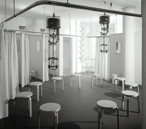 Lubetkin's Finsbury Health Centre. The ground floor electric treatment room provided some much needed sunshine for patients. Stools were designed by Alvar Aalto.