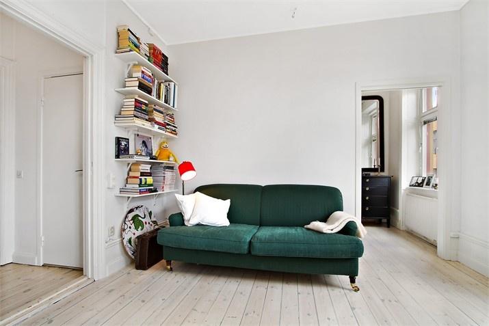 Grön soffa - Fastighetsbyrån