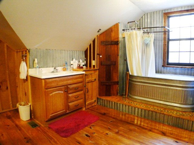 Imagine soaking in this custom watering-trough bathtub, 840 Sanders Road Franklin NC, Log Home for Sale with Acreage