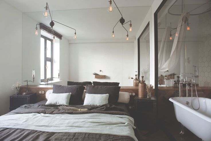 archventil_interior_design_flat_krms-19 interior design - bedroom and bathroom - glass wall - black metal profiles - fish bone parquet floor and wall surface - consolle - mirror - industrial lamps and bedside tables - black and mint green linen - flowers