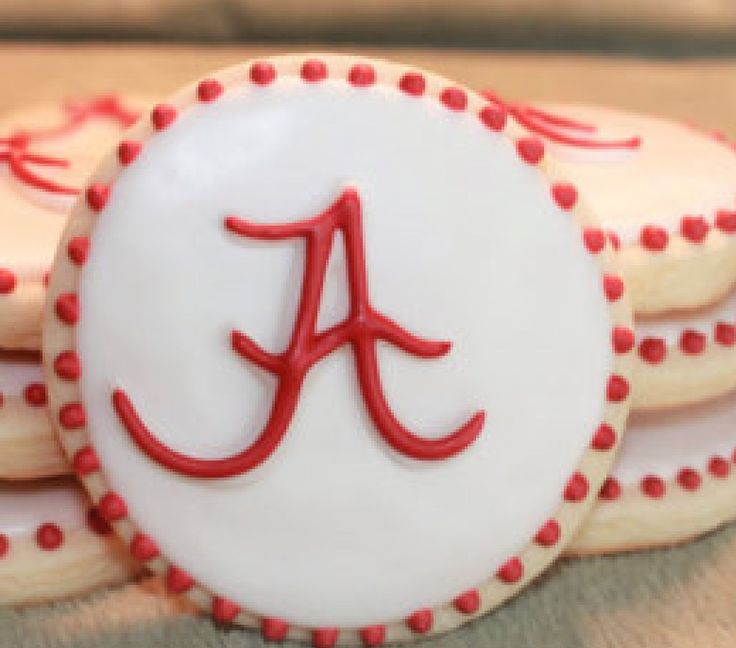 Grooms dad played football at Alabama . His number was 13. Chocolate wafer iced in GOLD