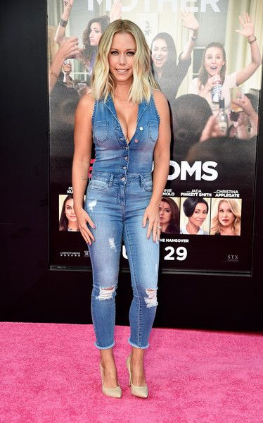 Kendra Wilkinson Jumpsuit - Kendra Wilkinson showed off her assets in a low-cut denim jumpsuit during the premiere of 'Bad Moms.'