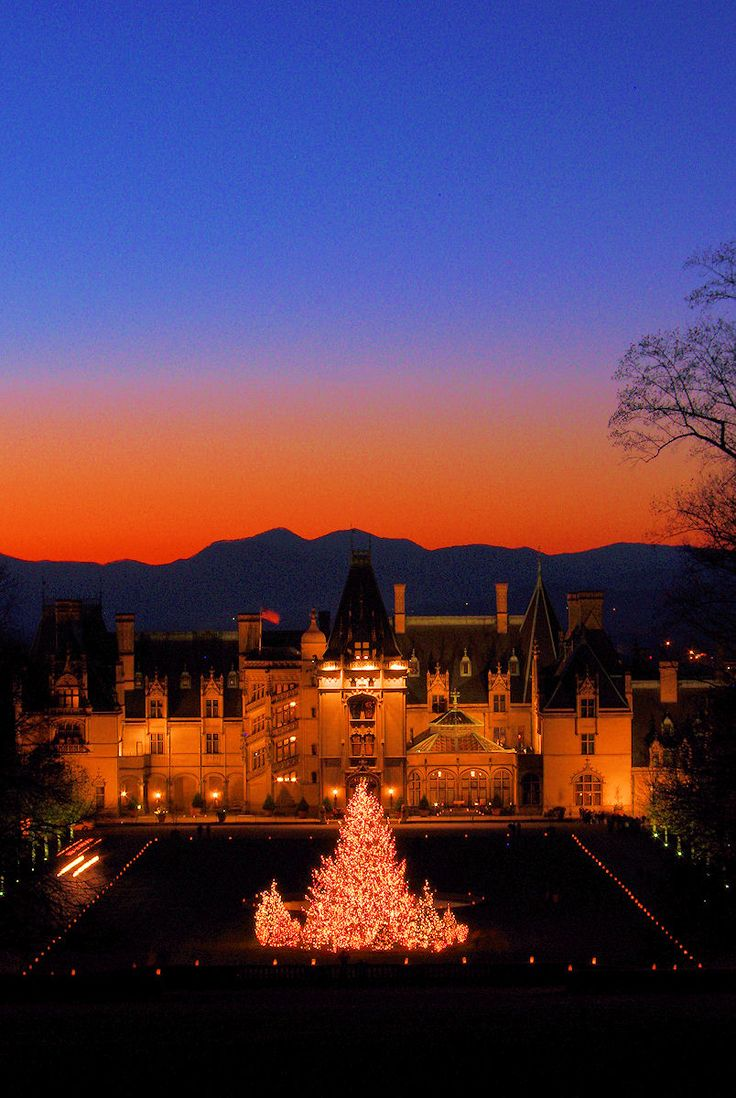 Christmas at #Biltmore House with a mountain sunset. Plan a visit: http://www.romanticasheville.com/biltmorechristmas.htm