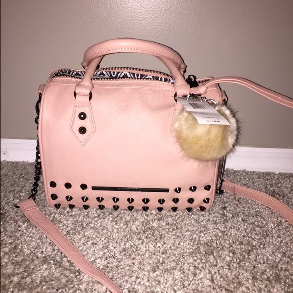 "SALE Steve Madden Studded Satchel⭐️ ⭐️NWT⭐️ Steve Madden ""Balexa 2"" Studded Satchel ❤️ Color is blush❤️ Studs are black❣ Long strap included This bag is awesome  Pom not included if you would like to purchase I can add $15 to the listing so please let me know beforehand. Steve Madden Bags Satchels"