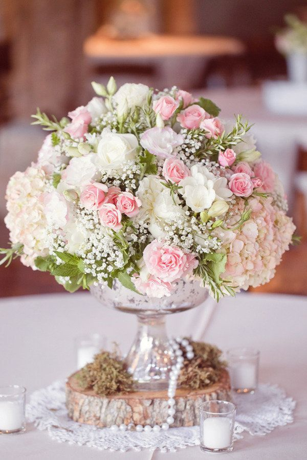 Shabby chic blush pink and white rose, hydrangea, and baby's breath floral arrangement for rustic vintage wedding centerpiece